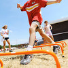 Globe/T. Rob Brown Six-year-old Aidan Koch, of Joplin, runs through a football drill while sporting a Chiefs shirt Thursday afternoon, Aug. 23, 2012, at Beacon School, the former Joplin School District administration offices. Administration and personnel for the Kansas City Chiefs helped build a new playground alongside Joplin School District personnel and volunteers.