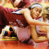 Joplin's Bailey Taylor competes with Seneca's Elena Wood for a loose ball Thursday night, Dec. 19, 2013, at Seneca High School's gymnasium. Globe | T. Rob Brown