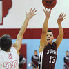 Joplin's Carlos Santillan shoots over Webb City's Clay Gardener during Friday night's game, Dec. 20, 2013, at Webb City's gymnasium.<br /> Globe | T. Rob Brown