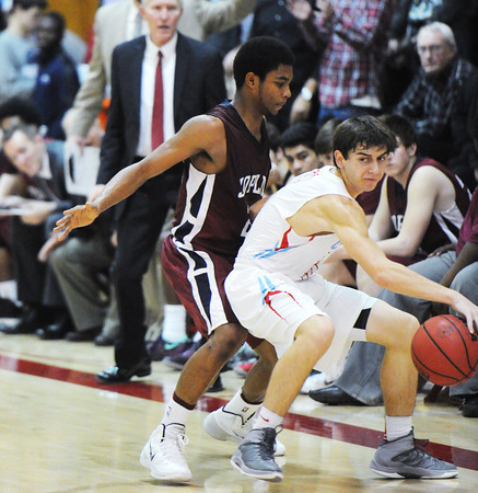 Joplin's Keiondre Adams puts defensive pressure on Webb City ball handler Tanner Yokley during Friday night's game, Dec. 20, 2013, at Webb City's gymnasium. Globe | T. Rob Brown