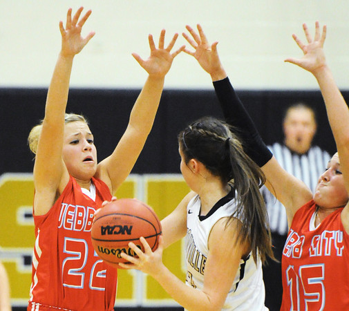 Webb City's Lexey Kneib (22) and Mikaela Burgess (15) put defensive pressure on Bentonville's Kindal Coleman during Saturday evening's game, Dec. 28, 2013, during the 59th Annual Neosho Holiday Classic at Neosho High School's gymnasium. Globe | T. Rob Brown