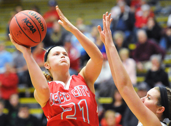 Webb City's Desirea Buerge goes up for a shot over a Bentonville defender during Saturday evening's game, Dec. 28, 2013, during the 59th Annual Neosho Holiday Classic at Neosho High School's gymnasium. Globe | T. Rob Brown