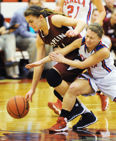 Joplin's Marissa Queen competes with Seneca's Willow Rhoades for a loose ball Thursday night, Dec. 19, 2013, at Seneca High School's gymnasium. Globe | T. Rob Brown