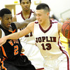 Joplin's Carlos Santillan drives past Webster Groves' Leland Bradford during the championship game of the Kaminsky Classic on Staurday afternoon at Robert Ellis Young Gymnasium. Globe | Laurie Sisk