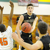 Neosho's Kaden Roy (10) dishes off to Lukas Werneke during their game against Webster Groves in the first round of the 2014 Kaminsky Classic on Thursday afternoon at Robert Ellis Young Gymnasium.<br /> Globe | Laurie Sisk