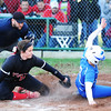 Lamar pitcher Emmie Robertson covers the plate as Marionville's Haley Lane attempts to slide home Monday evening, Oct. 21, 2013, at Lamar's field. The runner was called out to end the inning.<br /> Globe | T. Rob Brown
