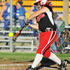 Carl Junction's Katlyn Frazier makes contact with the ball against Carthage Monday evening, Sept. 30, 2013, at Carl Junction's softball field.<br /> Globe | T. Rob Brown