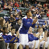 UMass Lowell fans and players cheer a UML basket. (SUN/Julia Malakie)