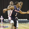 UMass Lowell's Akeem Williams and Duquesne's Derrick Colter reach for a loose ball. (SUN/Julia Malakie)