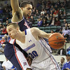 UMass Lowell's Mark Cornelius (30), guarded by Duquesne's Isaiah Watkins (13). (SUN/Julia Malakie)