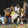 UMass Lowell's Akeem Williams (11) tries to get past Dusquesne's Derrick Colter (1) and Ovie Soko (0). (SUN/Julia Malakie)