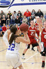 Danville's Emily Cameron (#32) and Cardinal's Lexi Fullenkamp (#21) and Delaney Ridgway (#31)