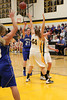 Danville's Kinsey Petersen (#21), Carlee Kelly (#3) and Central Lee's Kelsey Bryant (#44) and Britany Mathison (#30)
