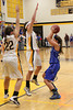 Danville's Allie Boyer (#23) and Central Lee's Josey Kirchner (#22) and Britany Mathison (#30)