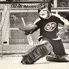 Johnson goalie Jeff Halsten deflects the puck during a City Conference game at the Civic Center against Harding on Jan. 27, 1975. Johnson won, 3-2. (Pioneer Press file photo)