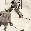 Johnson goalie Jeff Halsten clears the puck in front of Washburn's Paul Rutt on Feb. 17, 1975. (Pioneer Press file photo)