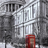 Red telephone box in front of St Paul's Cathedral in London