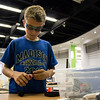 A boy examines a piece of Lego in the EPL Makerspace.  Taken on July 16, 2014 by James Cadden.