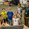 Joey da Costa and Naomi Onishi pose with a group of customers inside the EPL Makerspace.  Taken on July 16, 2014 by James Cadden.