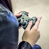 A girl gamer enjoy the Playstation in the EPL Makerspace.  Taken on July 7, 2014 by James Cadden.
