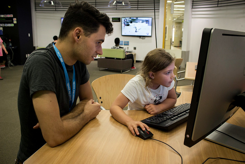 EPL Summer Programmer, Joey da Costa, assists a young library customer in the EPL Makerspace.  Taken on July 16, 2014 by James Cadden.