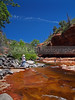 (Sedona, Arizona) Oak Creek and Oak Creek Canyon meander south between Flagstaff and Sedona, Arizona.  Along its path is Slide Rock where the creek runs across a section of red, Sedona rock.  It is a popular place for kids of all ages.