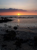 (Hawaii, Big Island) The Mauna Lani beach on the Kona coast is another favorite spot to witness sunsets in Hawaii.  This image captures the ocean lapping on the lava rocks while the sun disappears in the horizon.