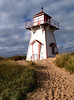 Red and white lighthouse on Prince Edward Island, Canada.