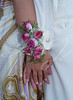 Pink Rose Wrist Corsage--Pink rose wrist corsage with babies breath and green and white ribbons.