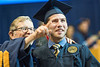 30438; s0560xx; 30438; december commencement; 2014; photo greg ellis; l to r e gordon gee; justin boyle mechanical aerospace engineering pittsburgh pa; campus scene; hug