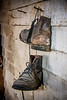 Old boots hanging on Wall