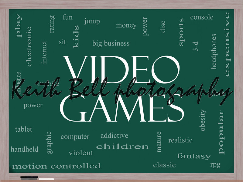 Video Games Word Cloud Concept on a Blackboard with great terms such as addictive, violent, children, play, rating, fun and more.