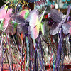 Butterfly wands for sale at a crafts booth. Very colorful and playful image.
