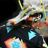 A Native American performs a traditional hoop dance