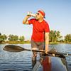 kayak paddler drinking water