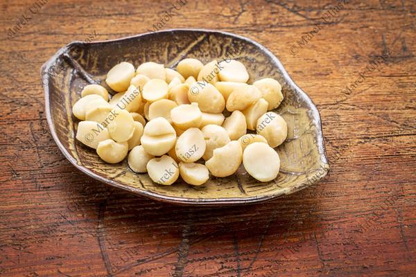 macadamia nuts on leaf bowl