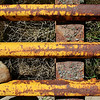 Cattle Guard Abstract with Rock & Dried Grasses