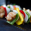 horizontal shot raw chicken kabob on a grill. shallow depth of field
