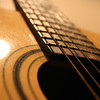 Close up shot of acoustic guitar. shallow dof.
