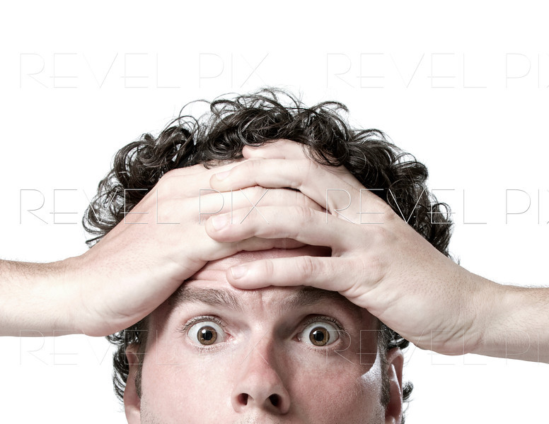 shot of man above the mouth holding hands against forehead in disbelief. oh no!