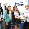 Sally Wheeler, far right, sales leader at nTelos in Lexington, presents a check to the Campus Kitchen at Washington and Lee to support the Backpack Program. From left, Monique Toman, school counselor at Central Elementary School, Jenny Davidson, coordinator of student service-learning at W&L, Kathryn March-Soloway, W&L junior, and Wheeler