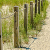 A rope and post beach fence