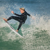 This is a tight crop of a young surfer at the top of his turn where he landed having made a 180 degree turn in mid air.