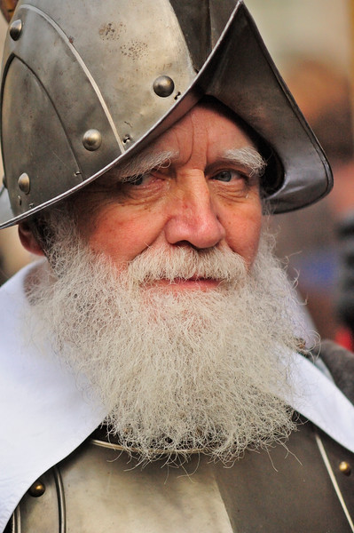 Detail of a bearded soldiertaking part in the Escalade festival,