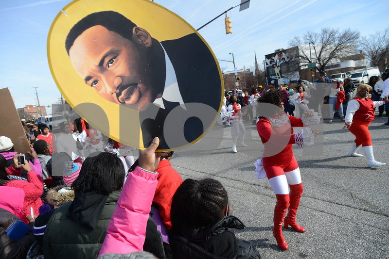 01.20.14 BALTIMORE, MD- Images for the 14th annual Dr. Martin Luther King, Jr. Parade presented by Forman Mills, which celebrates life and achievements of America's most influential civil rights leaders.  Thousands of spectators lined Martin Luther King, Jr Boulevard in Baltimore City to watch the Marching bands, floats, high stepping fraternities, civic leaders, color guards, and many other local organizations providing entertainment. (The Daily Record/Maximilian Franz)
