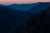 View of the sunset sky through Newfound Gap. On the distance, Gatlinburg lights start dotting the horizon. Great Smoky Mountains National Park, TN  TN-130328-0176