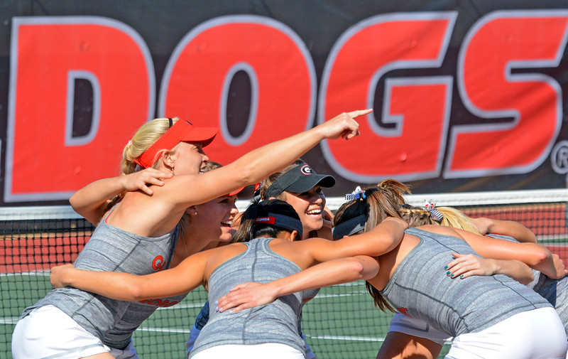 The team members get ready before Georgia's match with South Carolina on Friday, March 14, 2014, at the Dan Magill Tennis Complex. (Photo by Steven Colquitt)