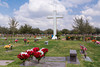 A cemetery with flowers and tombstones near McAllen, Texas, USA.