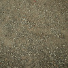stone as raw material for the construction of roads, streets, sidewalks, and background and texture