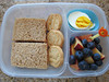 "Almond butter and jam sandwiches, Trefoil cookies, two hardboiled egg halves, nectarines and blueberries in an an EasyLunchbox: <a href=""http://bit.ly/ZZJJe6"">http://bit.ly/ZZJJe6</a>"